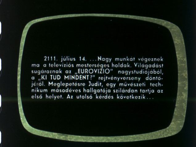 "July 14, 2111. ...Artificial television satellites are very busy today. They are transmitting a world broadcast from the main studio of ""EUROVISION"", the finals of the ""WHO KNOWS EVERYTHING?"" quiz contest. Surprisingly, Judit, a second-year student of an art college, is solidly in first place. The final question is next..."